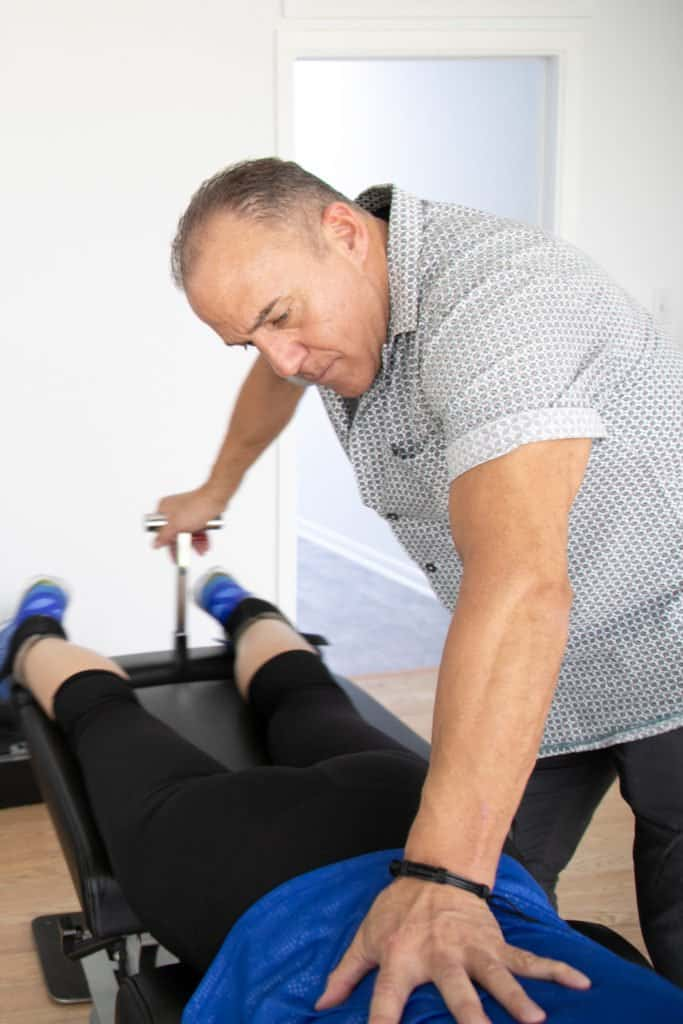 a patient having chiropractic care in boca Raton